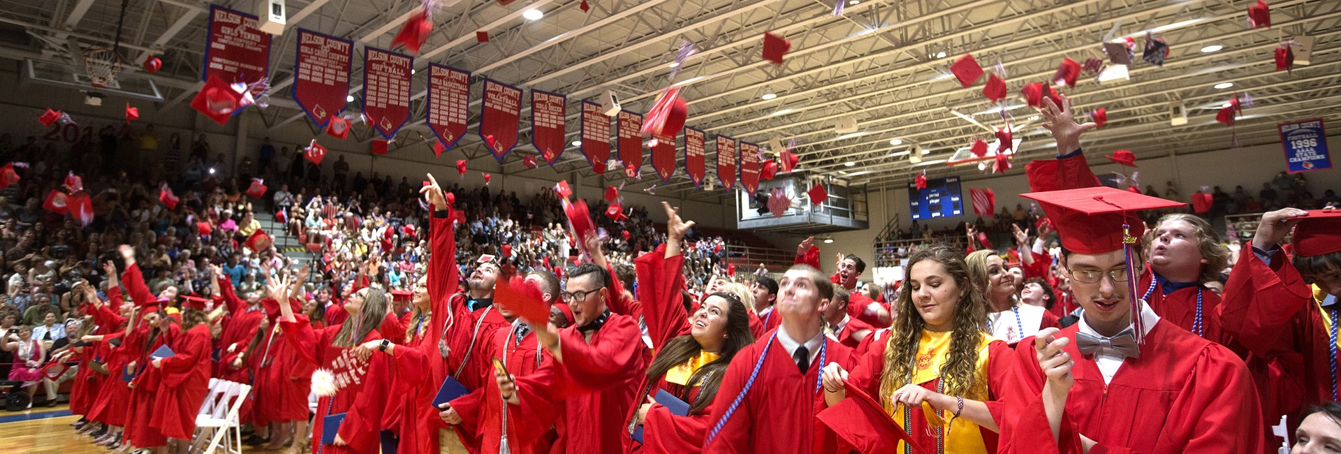 Graduates celebrate their accomplishment during graduation exercise.